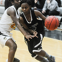Trask's Qua Schaffer drives on Topsail's Brandy Williams Friday December 5, 2014 at Topsail High School in Hampstead, N.C. (Jason A. Frizzelle)
