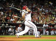 June 14 2011; Phoenix, AZ, USA; Arizona Diamondbacks batter Miguel Montero hits a three run home run during the sixth inning against the San Francisco Giants at Chase Field. Mandatory Credit: Jennifer Stewart-US PRESSWIRE.