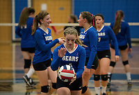 The Winnisquam Bear's take the court with Aubrey St. Onge at service during NHIAA Division III volleyball against Moultonboro on Monday evening.  (Karen Bobotas/for the Laconia Daily Sun)