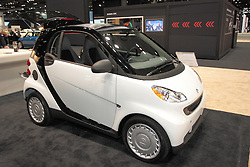 "11 February 2009: Smart fourtwo pure coupe. All smart fortwos come packed with standard safety features that are more likely to be found in luxury vehicles. This includes the protective ""tridion safety cell"", developed especially for the smart fortwo to help ensure crash compatibility with larger passenger cars, electronic stability program (esp¨), anti-lock braking system (abs), and four airbags, to name a few...The base pure model comes standard with convenience features such as a 5-speed automated manual transmission with manual or automatic mode, central remote locking system, 2-spoke leather steering wheel, and more. Be sure to check out the passion coupe and passion cabriolet that offer more standard features at an outstanding value.. The Chicago Auto Show is a charity event of the Chicago Automobile Trade Association (CATA) and is held annually at McCormick Place in Chicago Illinois."
