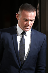 © Licensed to London News Pictures . 18/09/2017. Stockport, UK. Everton footballer WAYNE ROONEY leaves Stockport Magistrates court after facing a drink-driving charge . The former England and Manchester United captain was arrested by police whilst driving in Wilmslow in Cheshire during the early hours of 1st September . Photo credit: Joel Goodman/LNP
