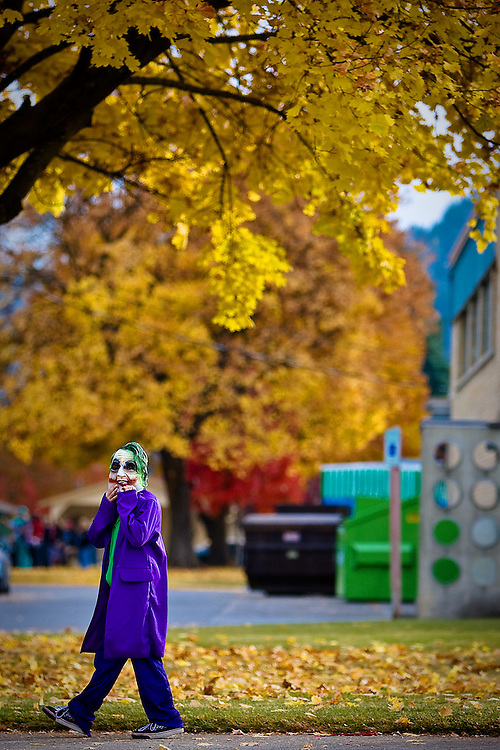 JEROME A. POLLOS/Press ..A Borah Elementary student, dressed as the Joker from Batman, walks beneath the fall foliage in front of the school Friday during a Halloween parade to Bestland Retirement Community and Pinewood Care Center.