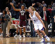 Kansas State guard Claire Coggins (14) reacts along with Texas A&M center La Toya Micheaux (12) after the Wildcats upset 17th ranked Texas A&M 48-45 at Bramlage Coliseum in Manhattan, Kansas, January 6, 2007.
