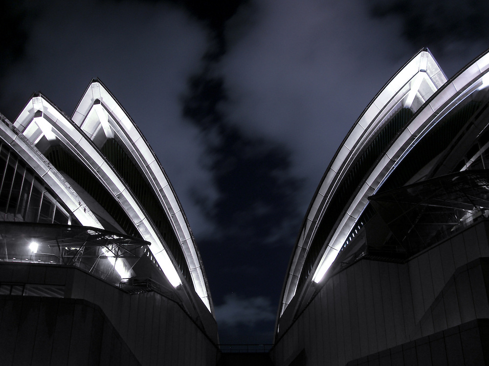 Sydney Opera House sails at night.