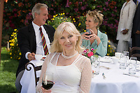 Three friends drinking wine outdoors