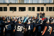 Eastridge players huddle before a game against Greece Arcadia at Eastridge High School on Friday, September 2, 2016.