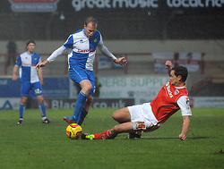 Bristol Rovers' David Clarkson is tackled by Morecambe's Stewart Drummond - Photo mandatory by-line: Dougie Allward/JMP - Tel: Mobile: 07966 386802 14/12/2013 - SPORT - Football - Morecombe - Globe Arena - Morecombe v Bristol Rovers - Sky Bet League Two