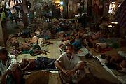 Sleeping workers at the Mach Bazaar.