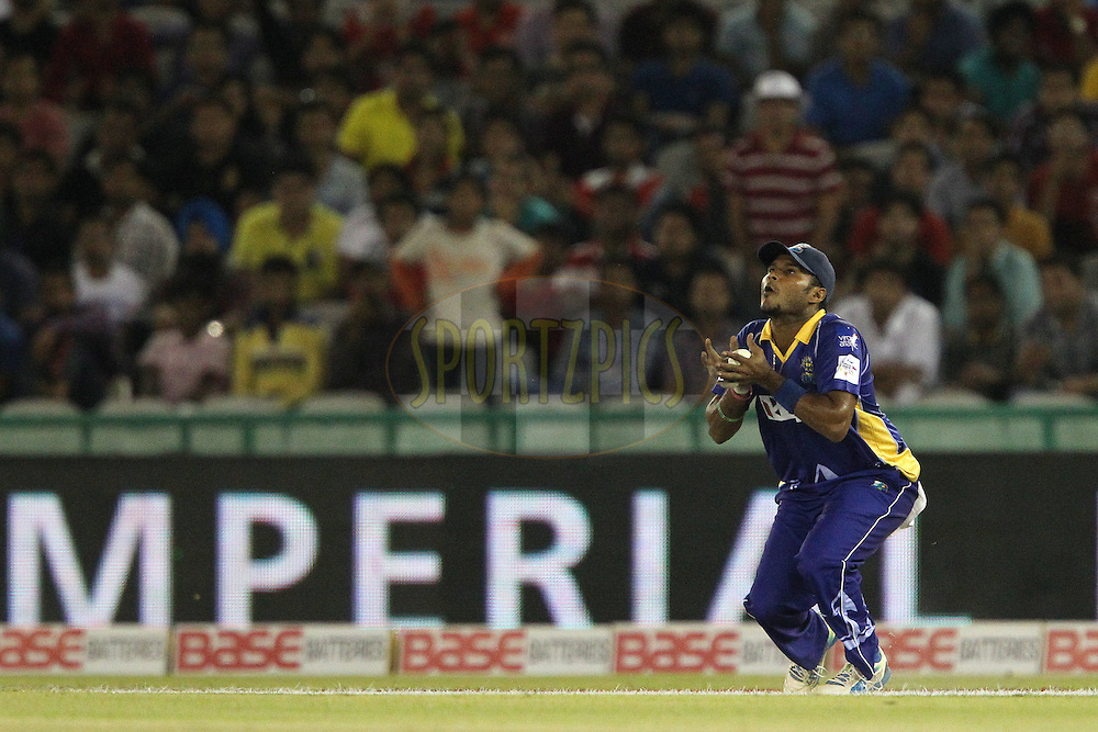 Dilshan MUNAWEERA of the Barbados Tridents takes the catch to dismiss Wriddhiman SAHA of the Kings XI Punjab  during match 5 of the Oppo Champions League Twenty20 between the Kings XI Punjab and the Barbados Tridents held at the Punjab Cricket Association Stadium, Mohali, India on the 20th September 2014<br /> <br /> Photo by:  Ron Gaunt / Sportzpics/ CLT20<br /> <br /> <br /> Image use is subject to the terms and conditions as laid out by the BCCI/ CLT20.  The terms and conditions can be downloaded here:<br /> <br /> http://sportzpics.photoshelter.com/gallery/CLT20-Image-Terms-and-Conditions-2014/G0000IfNJn535VPU/C0000QhhKadWcjYs