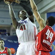 "Delaware 87ers Forward Keith ""Tiny"" Gallon (41) attempts as Maine Red Claws Center Zeke Marshall (44) defends in the first half of a NBA D-league regular season basketball game between the Delaware 87ers (76ers) and the Maine Red Claws (Boston Celtics) Friday, March. 21, 2014 at The Bob Carpenter Sports Convocation Center in Newark, DEL"