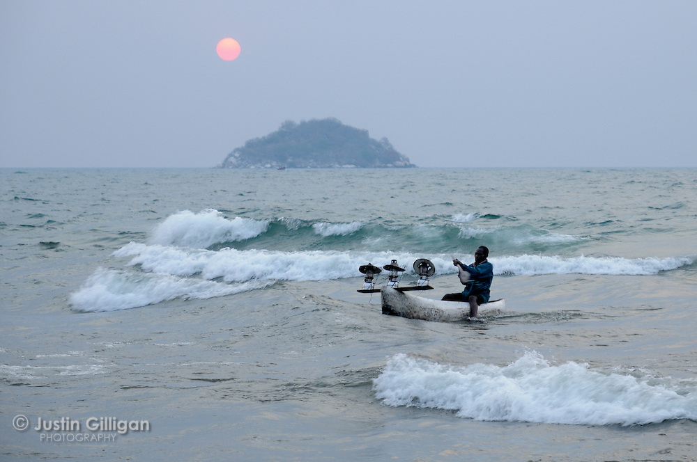 Fisher returns from an evening of usipa fishing at Senga Bay, Lake Malawi, Malawi.