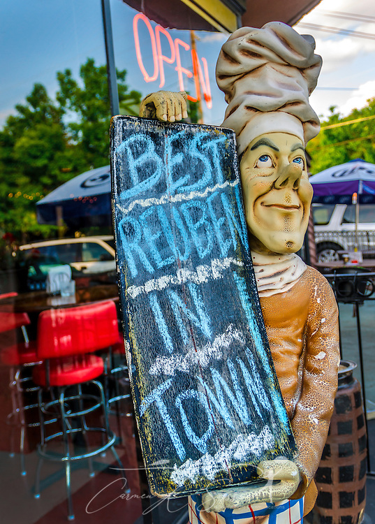 A statue holds a sign advertising the reuben sandwich at Chamblee Bistro in Chamblee, Georgia, May 20, 2014. (Photo by Carmen K. Sisson/Cloudybright)