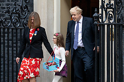 © Licensed to London News Pictures. 28/10/2019. London, UK. British Prime Minister Boris Johnson (right) buys a poppy from fundraisers for the Royal British Legion on the doorstep of 10 Downing Street. Photo credit : Tom Nicholson/LNP