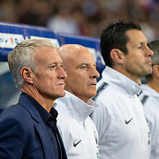 PARIS, FRANCE - September 10:  Didier Deschamps head coach of France and his assistant Guy Stephan and other staff members during the National Anthems before the France V Andorra, UEFA European Championship 2020 Qualifying match at Stade de France on September 10th 2019 in Paris, France (Photo by Tim Clayton/Corbis via Getty Images)