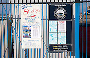 Signs for deep sea fishing trips at Watchet, Somerset, England