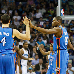 January 24,  2011; New Orleans, LA, USA; Oklahoma City Thunder small forward Kevin Durant (35) high fives Oklahoma City Thunder power forward Nick Collison (4) during the first quarter of a game against the New Orleans Hornets at the New Orleans Arena. Mandatory Credit: Derick E. Hingle