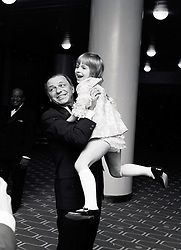FRANK SINATRA lifting up 7 year old KATIE BOWATER at a concert at The Royal Festival Hall, London on 8th May 1970.