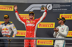October 21, 2018 - Austin, TX, U.S. - AUSTIN, TX - OCTOBER 21: Ferrari driver Kimi Raikkonen (7) of Finland hoists the trophy high after winning the F1 United States Grand Prix on October 21, 2018, at Circuit of the Americas in Austin, TX. (Photo by Ken Murray/Icon Sportswire) (Credit Image: © Ken Murray/Icon SMI via ZUMA Press)