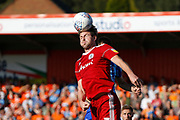 Mark Hughes of Accrington heads clear during the EFL Sky Bet League 1 match between Accrington Stanley and Blackpool at the Fraser Eagle Stadium, Accrington, England on 21 September 2019.