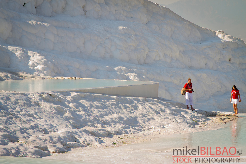 Travertine terrace formations and tourists. Pamukkale. Denizli province. Anatolia. Turkey.