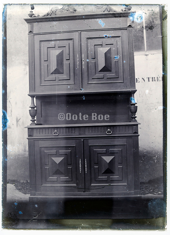 early 1900s product photo of closed cabinet closet