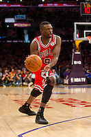 25 December 2011: Forward Luol Deng of the Chicago Bulls passes the ball against the Los Angeles Lakers during the first half of the Bulls 88-87 victory over the Lakers at the STAPLES Center in Los Angeles, CA.