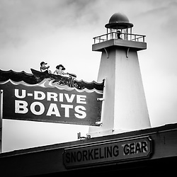 U-Drive Boats sign and lighthouse black and white photo on Catalina Island Avalon California. Catalina Island is a popular travel destination off the coast of Southern California in the United States.