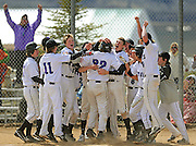 Byron Hetzler/Sky-Hi News.Middle Park's Matt Hydrusko (32) is mobbed by his teammates at home plate after hitting a walk-off home run to defeat Bennett 7-6 on Friday in Granby.  The win clinched the Frontier League championship for the Panthers.