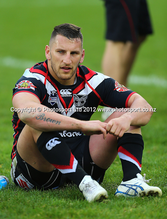 Lewis Brown sits dejectedly after the loss during the NRL game, Vodafone Warriors v Penrith Panthers, Mt Smart Stadium, Auckland, Sunday 19 August  2012. Photo: Simon Watts /photosport.co.nz