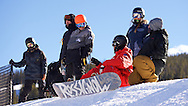 Chloe Kim chats with coaches and other riders at the top of the superpipe at Copper Mountain in Copper Mountain, CO. ©Brett Wilhelm/ESPN