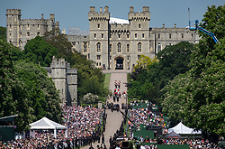 © Licensed to London News Pictures. 19/05/2018. Windsor, UK. The Duke and Duchess of Sussex's carriage procession enters Windsor Castle after travelling through the streets surrounding the castle. Photo credit: Peter Macdiarmid/LNP