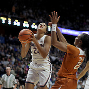 UNCASVILLE, CONNECTICUT- DECEMBER 4:  Napheesa Collier #24 of the Connecticut Huskies drives to the basket defended by Brianna Taylor #20 of the Texas Longhorns  during the UConn Huskies Vs Texas Longhorns, NCAA Women's Basketball game in the Jimmy V Classic on December 4th, 2016 at the Mohegan Sun Arena, Uncasville, Connecticut. (Photo by Tim Clayton/Corbis via Getty Images)