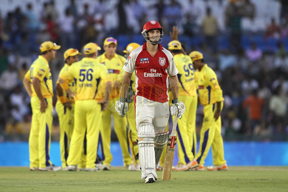 A dejected Shaun Marsh of the Kings XI Punjab after getting out while Chennai Super Kings celebrate during match 9 of the Indian Premier League ( IPL ) Season 4 between the Kings XI Punjab and the Chennai Super Kings held at the PCA stadium in Mohali, Chandigarh, India on the 13th April 2011..Photo by Shaun Roy/BCCI/SPORTZPICS