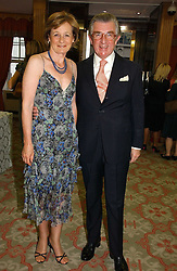 MR & MRS GEORGE MAGAN at a private view of the forthcoming sale 'Property from the collection of HRH The Princess Margaret, Countess of Snowdon' and a private view of art by Marina Karella Princess Michael of Greece, held at Christie's, 8 King Street, London SW1 on 12th June 2006.<br />