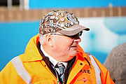A Wycombe Wanderers steward with lots of badges on his hat before the EFL Sky Bet League 1 match between Wycombe Wanderers and Peterborough United at Adams Park, High Wycombe, England on 3 November 2018.