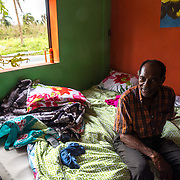 SEPTEMBER 25 - LOIZA, PUERTO RICO - <br /> Santiago Qui&ntilde;ones Escalera, 73, sits on an air mattress he and his wife are sleeping in these days in the coastal area of Pi&ntilde;ones in Loiza which sustained heavy damage by the destructive path of Hurricane Maria. Qui&ntilde;ones owns the bar/restaurant in front of the ocean and he decided he and his wife should ride the storm out there. Fortunately the building held up. They use a generator and solar powered lighting.<br /> (Photo by Angel Valentin for NPR)