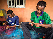 15 JUNE 2105 - NARATHIWAT, NARATHIWAT, THAILAND:  Fishermen repair their nets in Narathiwat.      PHOTO BY JACK KURTZ
