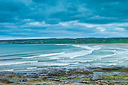 Beach and waves at Lahinch (Lehinch) famous surfing beach in County Clare, West Coast of Ireland