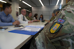 Image shows troops from 77 Brigade meeting with officials from the British Embassy in Manila, Philippines at the Start of Exercise Civil Brigge 15A. 20/04/2015.<br /> Credit should read: Cpl Mark Larner MOG.<br /> <br /> Exercise Civil Bridge is being conducted by elements of 77 Brigade &ndash; a specialist British military unit that is working alongside the government and disaster relief organisations as part of an annual overseas training exercise. <br /> <br /> Their mission during the two-week deployment will be to look at examples of the existing Philippine earthquake contingency response plans and, working with Philippine colleagues, make suggestions that will help save lives by enhancing the country&rsquo;s ability to respond to an earthquake in an urban setting.