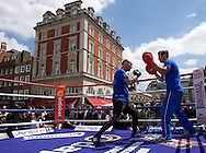Kevin Mitchell works on the pads with Trainer Tony Sims during a public workout in Covent Garden, London<br /> Picture by Alan Stanford/Focus Images Ltd +44 7915 056117<br /> 26/05/2015