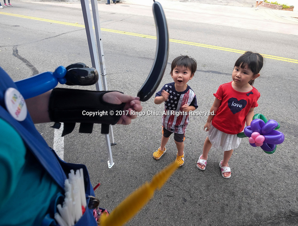 Children wait for the balloon during National Night Out in San Gabriel, California, on Tuesday, Aug. 1, 2017. National Night Out is a community-police awareness-raising event in the United States and Canada, held the first Tuesday of August. Texas and Florida have the option to use the alternate date of the first Tuesday in October to avoid hot weather.(Photo by Ringo Chiu)<br /> <br /> Usage Notes: This content is intended for editorial use only. For other uses, additional clearances may be required.