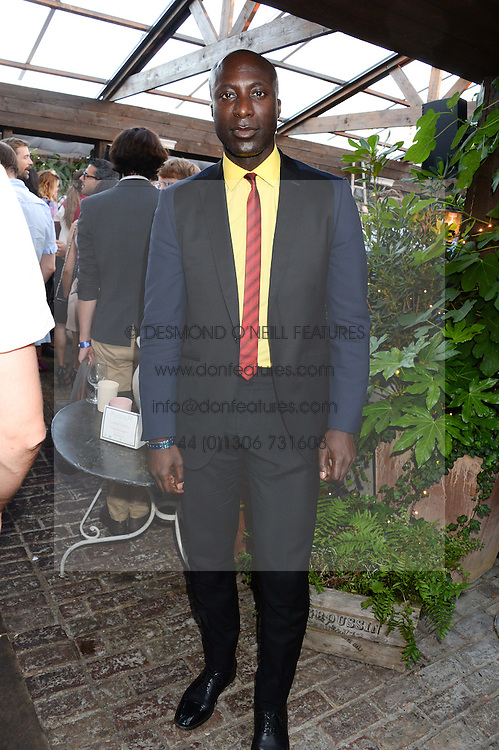OZWALD BOATENG attending the Warner Bros. & Esquire Summer Party held at Shoreditch House, Ebor Street, London E1 on 18th July 2013.