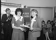Typist Of The Year.1983.17.11.1983.11.17.1983.17th november 1983..Ms Paula Sommers won the award of Typist Of The Year which was jointly sponsored by The Irish Times and B & I Lines..Image of Ms Sommers,of I.D.L., being presented with her award by last years winner, Ms Valerie Duff. The award ceremony was held at the Irish Times,Training Centre , Nth Frederick Street,Dublin