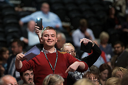 © Licensed to London News Pictures . 30/09/2015 . Brighton , UK . Delegates wave from the audience in order to be called from the floor to speak . The 2015 Labour Party Conference . Photo credit : Joel Goodman/LNP