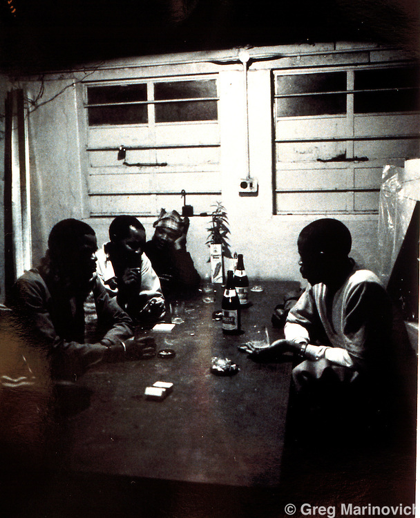 1989, eveing in Mamelodi Hostel, Pretoria. Scan of original polaroid. Greg Marinovich