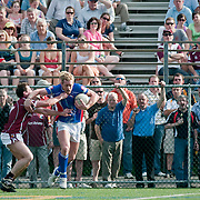 May 2, 2010 - Bronx, NY : New York's Adrian O'Connor (#9) stiffarms an opponent. The New York Gaelic Athletic Association  hosted the Galway Tribesmen this past Sunday at Gaelic Field in Riverdale for the opening match of the 2010 Connacht Football Championship. The hosts gave their overseas visitors a ferocious 60 minutes of play before falling 2-13 to 0-12.
