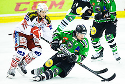28.11.2014, Hala Tivoli, Ljubljana, SLO, EBEL, HDD Telemach Olimpija Ljubljana vs EC KAC, 22. Runde, in picture Daniel Ban (EC KAC, #11) vs Ales Music (HDD Telemach Olimpija, #16) during the Erste Bank Icehockey League 22. Round between HDD Telemach Olimpija Ljubljana and EC KAC at the Hala Tivoli, Ljubljana, Slovenia on 2014/11/28. Photo by Morgan Kristan / Sportida