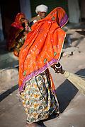 Woman sweeper in sari (India)