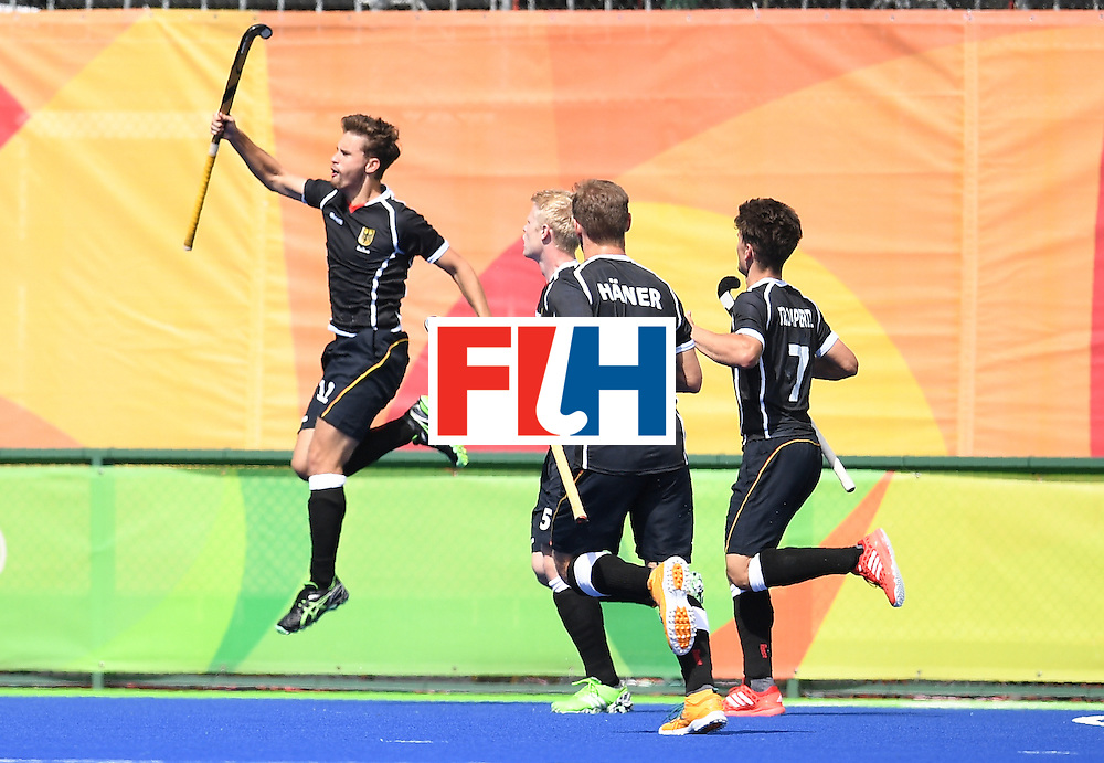 Germany's Timm Herzbruch (L) celebrates scoring a goal during the men's field hockey Argentina vs Germany match of the Rio 2016 Olympics Games at the Olympic Hockey Centre in Rio de Janeiro on August, 11 2016. / AFP / MANAN VATSYAYANA        (Photo credit should read MANAN VATSYAYANA/AFP/Getty Images)