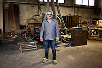 GUIDONIA, ITALY - 7 MARCH 2013: Emanuele Tedeschi, the 49 years old owner of the Temeca woodworking shop, poses in front of the machinery in Guidonia, Italy, on March 7, 2013. The Temeca woodworking shop was founded in 1959 by Renzo Tedeschi, 84, father of the current owner Emanuele Tedeschi. Until the 80's the Temeca woodworking shop had 16 employees; after the shop to Emanuele, Renzo's son, four employees retired and the number of the carpenters was reduced to 12.  After the 2009 crisis, the number of workers at the Temeca woodworking were reduced to 7..Gianni Cipriano for The International Herald Tribune